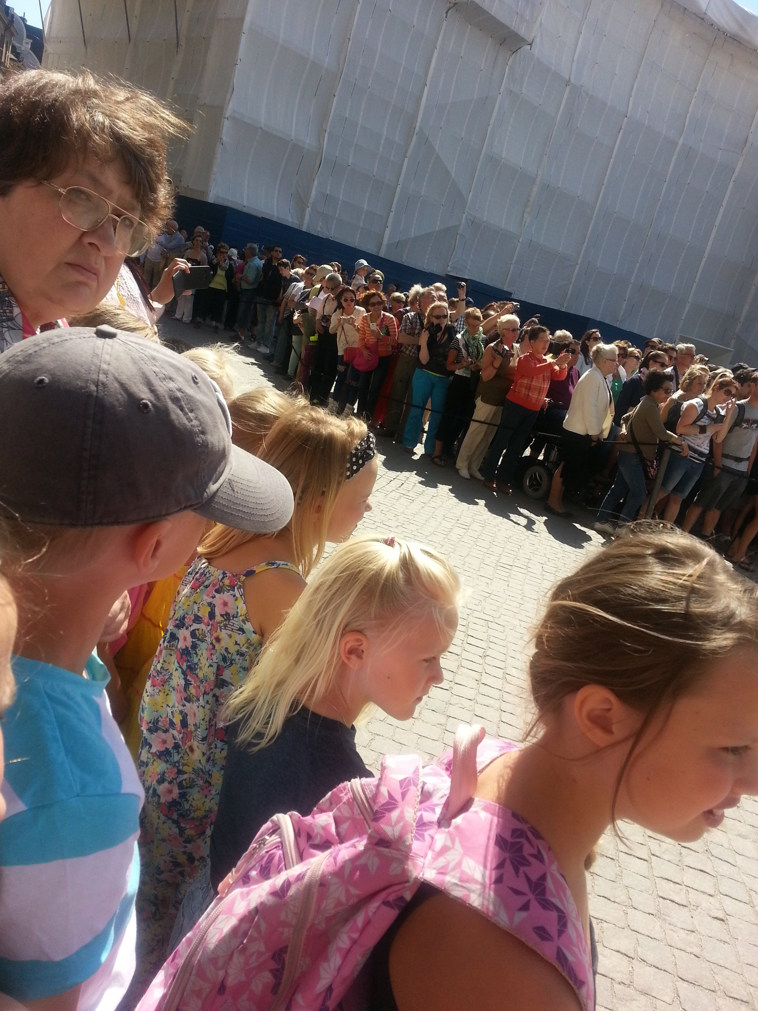Kids were standing to see pirate of changing guard at Stockholm's Royal Palace (Photo by the Author)